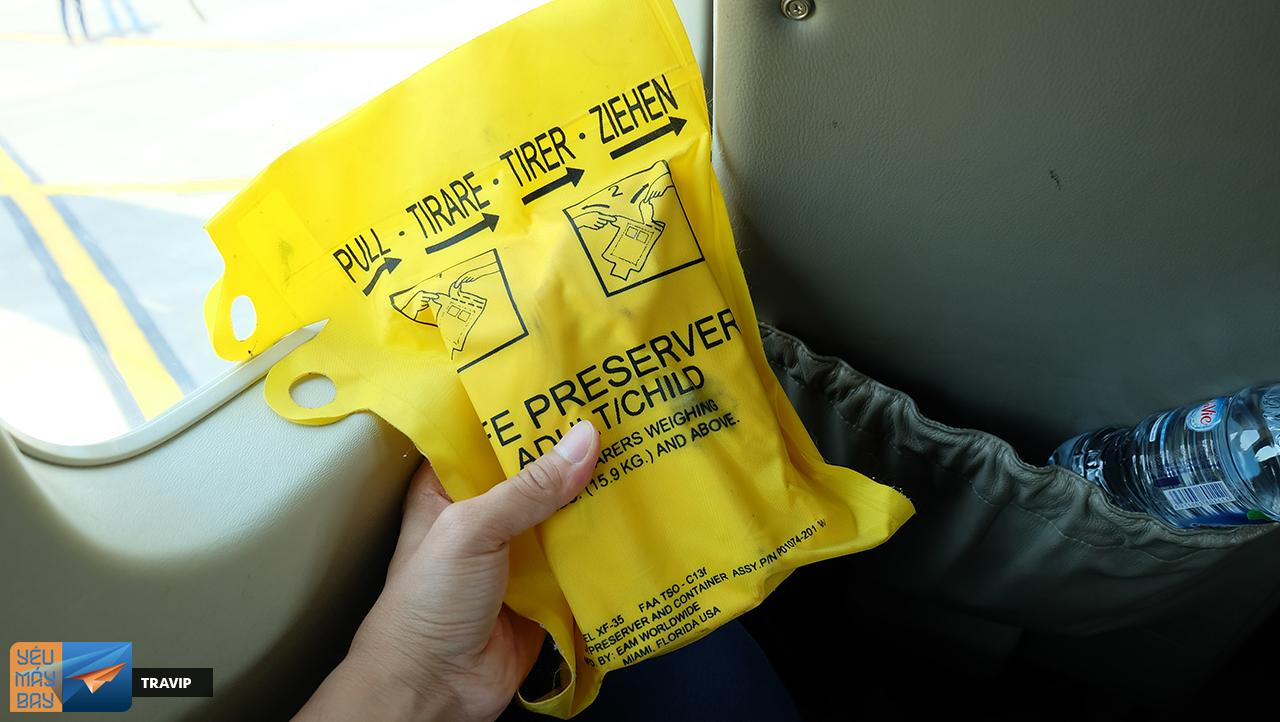 Life jackets are placed in the front seat bag.