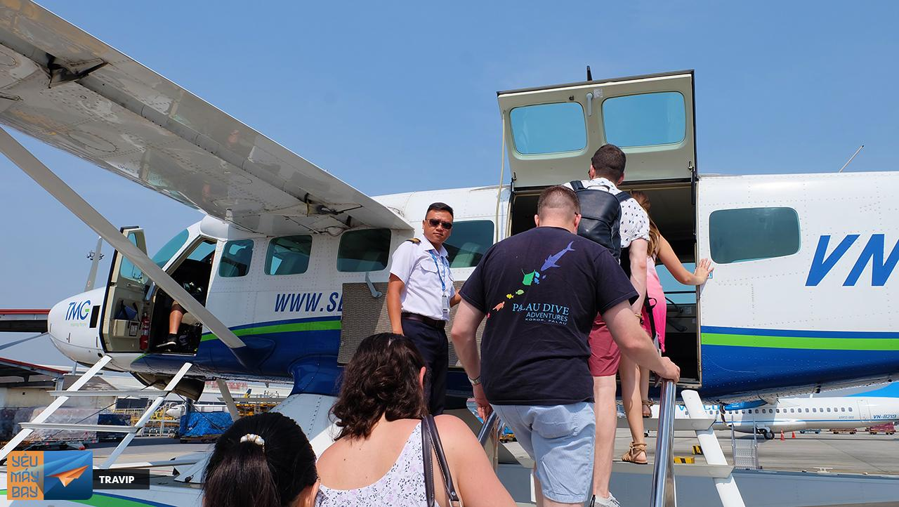 Passengers board the plane after being informed of safety instructions.